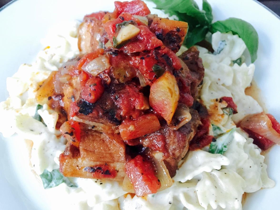 Bourbon-Braised Pork Belly over Creamy Bowtie Pasta